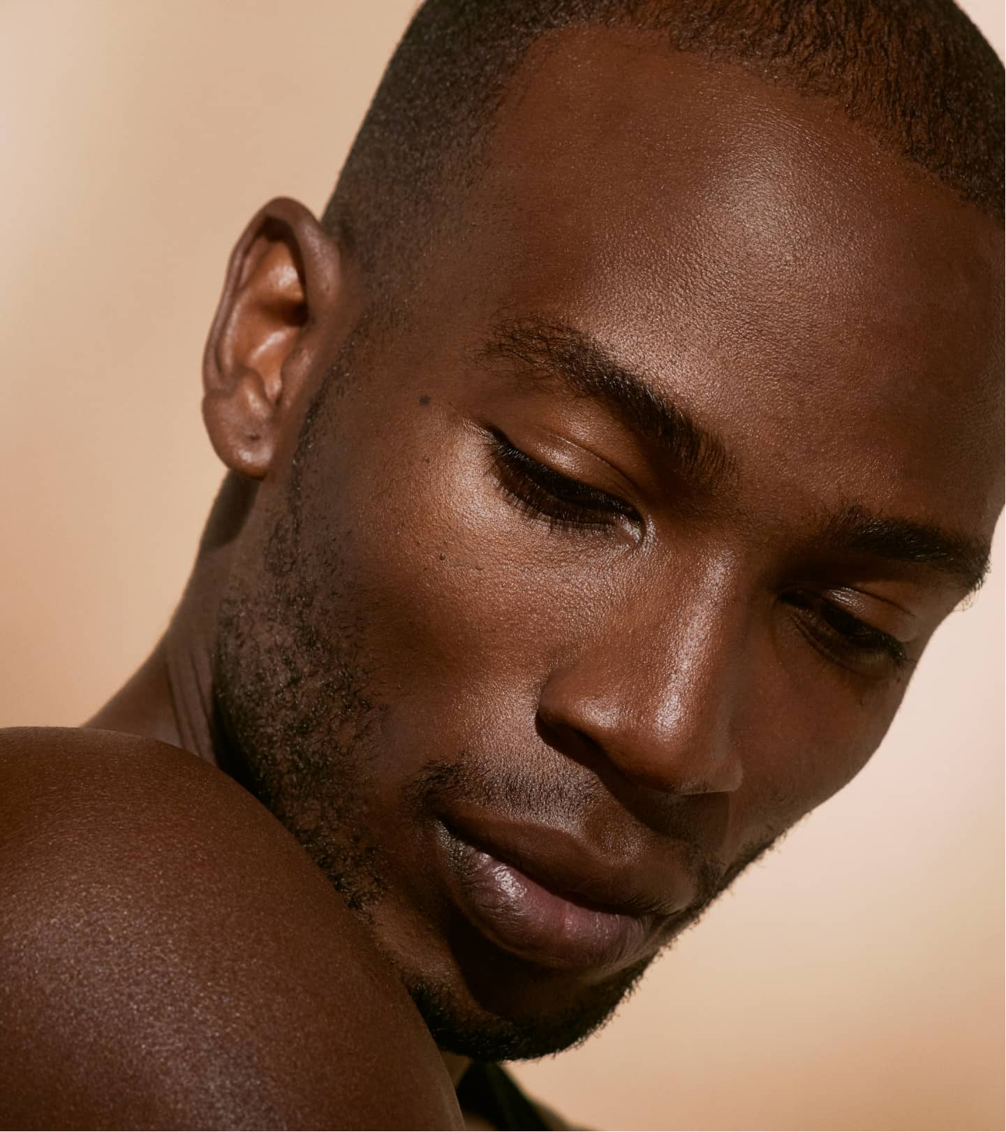 Man looking softly over his shoulder